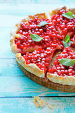 Tart with cream and berries Stock Images