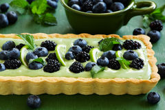 Tart with cream tea match. With summer berries Stock Photos