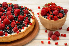 Tart  with creme, blueberries, raspberries and red currants. Royalty Free Stock Images