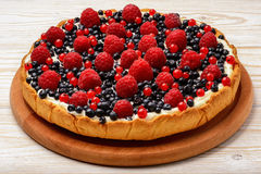 Tart  with creme, blueberries, raspberries and red currants. Tart  with creme, blueberries, raspberries and red currants Royalty Free Stock Image