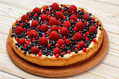 Tart  with creme, blueberries, raspberries and red currants. Tart  with creme, blueberries, raspberries and red currants Stock Photo