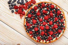 Tart  with creme, blueberries, raspberries and red currants. Tart  with creme, blueberries, raspberries and red currants Stock Image