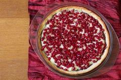 Tart with custard and pomegranate. Stock Photos