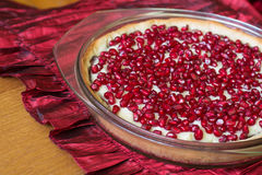 Tart with custard and pomegranate. Royalty Free Stock Photography