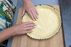 Tart dough. Female modeling tart dough in baking pan Stock Photography