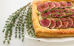 Tart with figs and Camembert. Puff pastry tart with figs, Camembert, thyme and honey Royalty Free Stock Photos