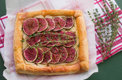 Tart with figs and Camembert. Puff pastry tart with figs, Camembert, thyme and honey Royalty Free Stock Photo
