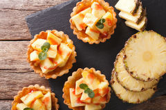 Tart filled with fresh pineapple and jam closeup. Horizontal top Royalty Free Stock Photo