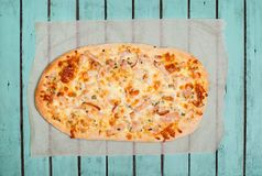 Tart Flambe or Flammkuchen on Shabby Chic Vintage Wooden Backgro. Und, Traditional Alsatian Pie, Rustic Style Stock Photography