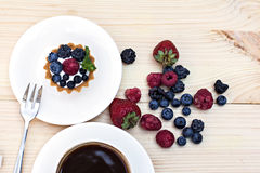 Tart  with Fresh berries. Dessert on wooden table close up Stock Image