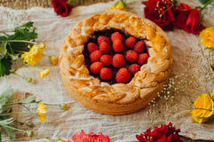 Tart with fresh berries. Homemade tart decorated with berries. Food: Cranberry and Raspberry upside down cake. a very natural an royalty free stock photos