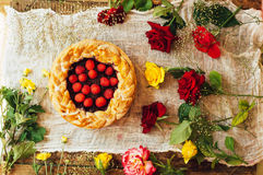 Tart with fresh berries.  Homemade  tart decorated with berries. Food: Cranberry and Raspberry upside down cake. a very natural an Stock Photography
