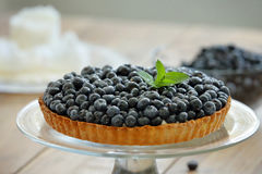 Tart with fresh blueberries on a wooden background.  Royalty Free Stock Photography