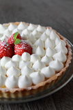 Tart with fresh cream. And strawberries Royalty Free Stock Image