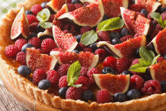 Tart with fresh figs, raspberries and blueberries macro. horizon Royalty Free Stock Photography