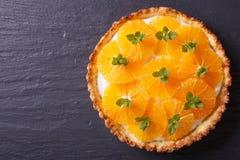 Tart with fresh orange and white cream top view horizontal Stock Photos