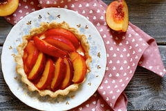 Tart with fresh peaches and plums Royalty Free Stock Photography