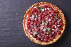 Tart with fresh raspberries and mint. Horizontal top view. Tart with fresh raspberries and mint on a table. horizontal view from above Stock Photos