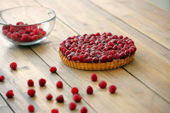 Tart with fresh raspberries on wooden background Royalty Free Stock Photo