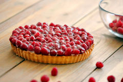 Tart with fresh raspberries on wooden background.  Stock Photos