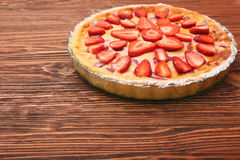 Tart with fresh strawberry on wooden background Royalty Free Stock Photo
