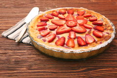 Tart with fresh strawberry on wooden background Royalty Free Stock Photography