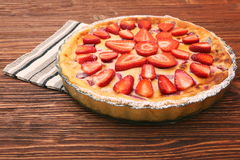 Tart with fresh strawberry on wooden background Royalty Free Stock Photos