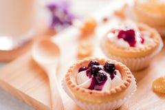 Tart fruit. On wooden tray Royalty Free Stock Photos