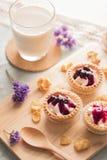 Tart fruit. On wooden tray Stock Photography