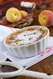Tart with jam of peaches and icing sugar at the wooden backgroun Stock Photo