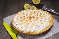 Tart with lemon and a soft Italian meringue royalty free stock photography