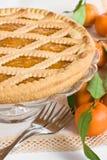 Tart with mandarins. Close up of a tart and some mandarins Royalty Free Stock Photos