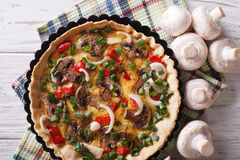 Tart with mushrooms closeup in baking dish. horizontal top view Royalty Free Stock Image