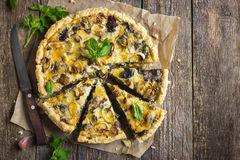 Tart with mushrooms, leek and cheese Stock Photo