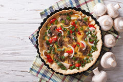Tart with mushrooms and vegetables in baking dish. horizontal to Stock Photography