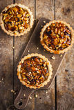 Tart with nuts and caramel Royalty Free Stock Image