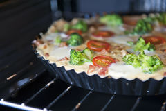 Tart in the oven Stock Photography
