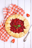 Tart of pastry with plums. On a blue background royalty free stock photos