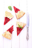 Tart of pastry with strawberry. On a white background stock photo