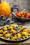 Tart with peach, pumpkin, plum and blueberry Stock Photo