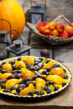 Tart with peach, pumpkin, plum and blueberry Royalty Free Stock Images