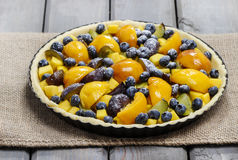 Tart with peach, pumpkin, plum and blueberry Stock Image