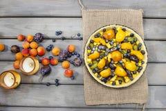 Tart with peach, pumpkin, plum and blueberry Stock Photo