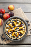 Tart with peach, pumpkin, plum, pear and blueberry in autumn set Stock Photography