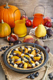Tart with peach, pumpkin, plum, pear and blueberry in autumn set Stock Image