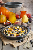 Tart with peach, pumpkin, plum, pear and blueberry in autumn set Stock Photos