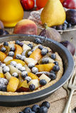 Tart with peach, pumpkin, plum, pear and blueberry in autumn set Royalty Free Stock Image