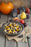 Tart with peach, pumpkin, plum, pear and blueberry in autumn set Royalty Free Stock Photos