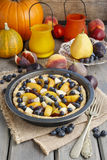 Tart with peach, pumpkin, plum, pear and blueberry Royalty Free Stock Photography