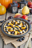 Tart with peach, pumpkin, plum, pear and blueberry Stock Photos